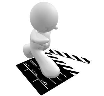 Guy icon surfing on film scene clap board