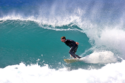surfer executing a bottom turn