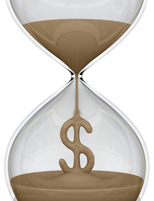 Hourglass. The sand falls forming the dollar sign.