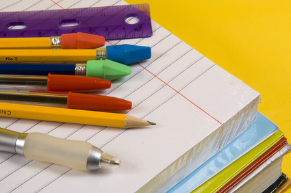 school supplies on yellow background