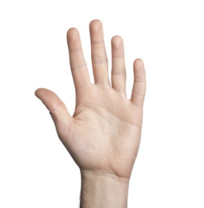 Close-up of human hand on white background
